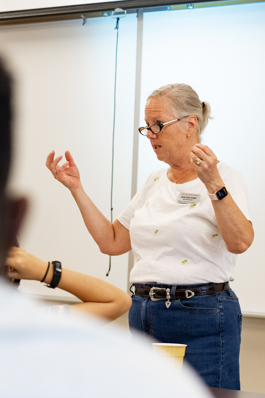 Heather Kemp teaches at the front of the clas