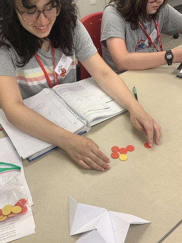 Gianna Claros (left) and Leo Johnson work on a problem.