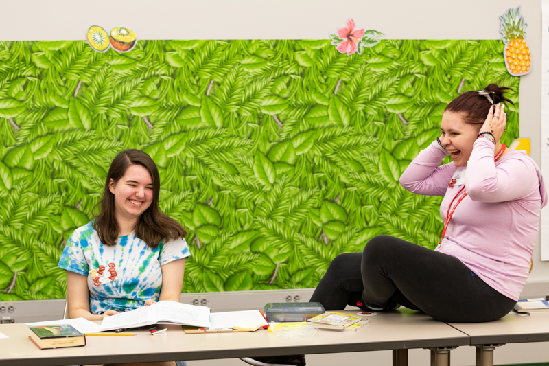 Cathleen Smalley and XX share a laugh in class.